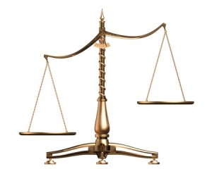 Brass Scales Of Justice Off Balance, Symbolizing Injustice, Over White
